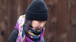Huawei chief financial officer Meng Wanzhou, leaves her home in Vancouver on Wednesday, December 12, 2018. THE CANADIAN PRESS/Jonathan Hayward