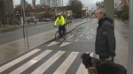 Graeme McCreath and his guide dog wait to cross a Victoria bike lane to get to a bus stop. The design of the lanes is the subject of a human rights complaint filed on behalf of the city's blind community. Dec. 12, 2018. (CTV Vancouver Island)