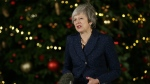 British Prime Minister Theresa May makes a statement outside 10 Downing Street, in London, Wednesday December 12, 2018.  (AP Photo/Tim Ireland)