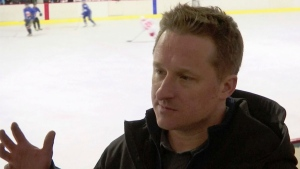 In this image made from video taken on March 11, 2016, entrepreneur Michael Spavor speaks during a friendly ice hockey match between visiting foreigners and North Korean players in Pyongyang, North Korea. A second Canadian man is feared detained in China in what appears to be retaliation for Canada's arrest of a top executive of telecommunications giant Huawei. The possible arrest raises the stakes in an international dispute that threatens relations. (AP Photo)