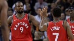 Toronto Raptors forward Serge Ibaka (9) celebrates with guard Kyle Lowry (7) during the second half of an NBA basketball game against the Golden State Warriors in Oakland, Calif., Wednesday, Dec. 12, 2018. (AP Photo/Jeff Chiu)