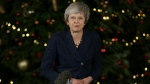 British Prime Minister Theresa May turns to walk back into 10 Downing Street after making a statement, in London, Wednesday December 12, 2018. (AP Photo/Tim Ireland)