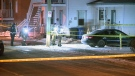 Police examine the front yard of a home in Charlemagne where the body of a man in his seventies was found on Dec. 12, 2018 (CTV Montreal/Cosmo Santamaria)