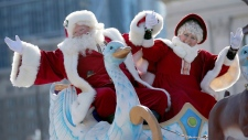 Santa and Mrs. Claus wave to spectators in this undated file photo. (AP)
