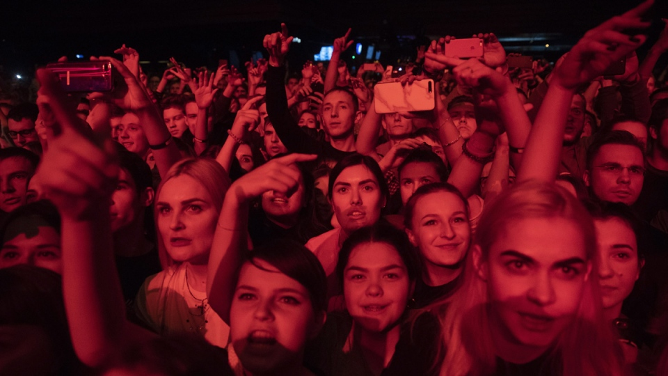 People cheer during a concert in support of rapper Husky, in Moscow, Russia. (Pavel Golovkin / AP)