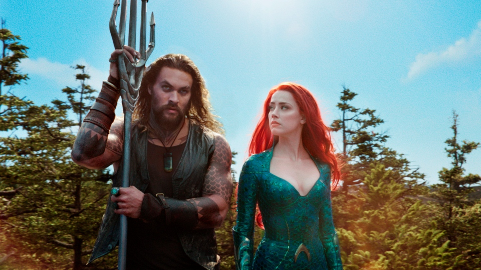 This image released by Warner Bros. Pictures shows Jason Momoa, left, and Amber Heard in a scene from