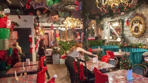 Staff put the finishing touches on Christmas decorations at the Miracle Montreal bar, Wednesday, December 5, 2018 in Montreal. (THE CANADIAN PRESS/Ryan Remiorz)