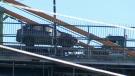 Car flips onto roof on Halifax bridge