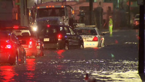 Cars struggled to pass through floodwaters on Burnaby's Still Creek Avenue on Thursday, Dec. 13, 2018.