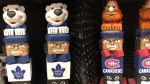 NHL-themed totem poles are shown at a Lawton's drug store. Halifax's former poet laureate, Rebecca Thomas, says she's received unprecedented online backlash for asking Lawton's drug store to remove the NHL merchandise that appropriates west coast Indigenous culture. (Rebecca Thomas/Twitter)