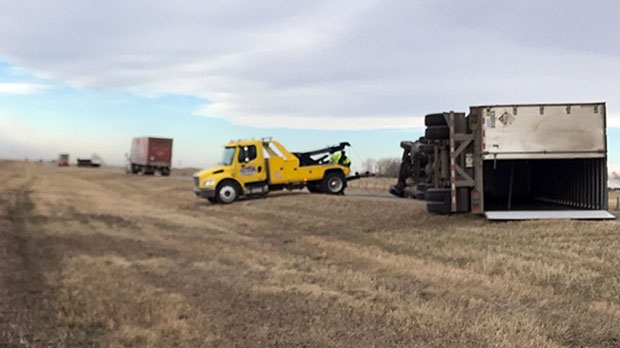A tow truck crew works to right a truck that tipped over on Highway 2, north of Fort Macleod.