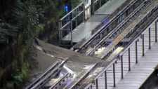 A small landslide covered part of the Millennium Line tracks at Commercial-Broadway Station on Thursday, Dec. 12, 2018.