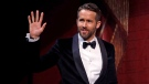 Actor Ryan Reynolds waves as he is introduced during a roast at Harvard University in Cambridge, Mass., Friday, Feb. 3, 2017. THE CANADIAN PRESS/AP, Charles Krupa