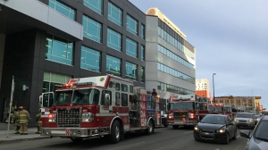 Calgary Fire Department crews outside of a building in the 200 block of 11 Avenue SW on Thursday afternoon following a bomb threat