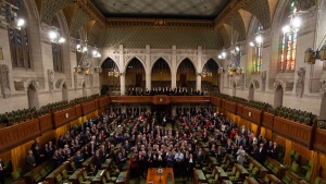 Members of the House of Commons pose for a photo in the chamber before Question Period in the House of Commons Wednesday December 12, 2018 in Ottawa. Centre block is slated to close for renovations following the fall session. THE CANADIAN PRESS/Adrian Wyld