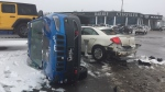 A Jeep lays on its side in a Barrie, Ont. dealership after a car smashes into its mounted display on Thursday, Dec. 13, 2018 (CTV News/Steve Mansbridge)