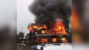 Flames were reportedly up to 12 feet high during a garage fire. (@ScottBTFS / Twitter)