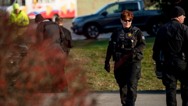 Deputies from the Washtenaw County Sheriff's Office investigate a reported bomb threat at Eat Local, Thursday, Dec. 13, 2018 in Scio Township, Mich. (Ben Allan Smith/Ann Arbor News via AP)