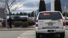 A still image from video by Castanet.net shows an RCMP SUV parked outside a car dealership in Penticton on Thursday, Dec. 13, 2018. (Castanet)