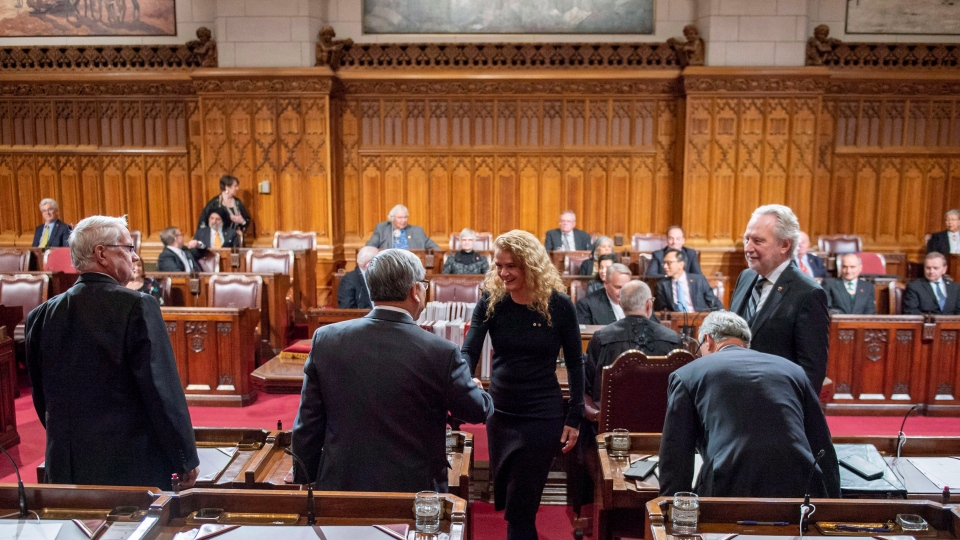 Governor General Julie Payette greets senators as she participates in a Royal Assent ceremony in the Senate Chamber on Parliament Hill in Ottawa on Thursday, Dec. 13, 2018. THE CANADIAN PRESS/Justin Tang
