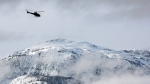 In this file image from March 14, 2010, a search and rescue helicopter heads toward a deadly avalanche site near Revelstoke, B.C. (THE CANADIAN PRESS/Jeff McIntosh)
