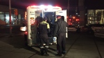 Paramedics treat a shooting victim in Toronto's downtown on Dec. 14, 2018.