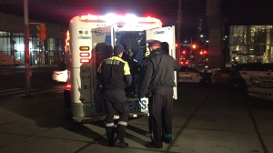 Paramedics treat a shooting victim in Toronto's downtown on Dec. 14, 2018.