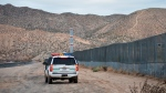 In this Jan. 4, 2016, file photo, a U.S. Border Patrol agent patrols Sunland Park along the U.S.-Mexico border next to Ciudad Juarez. A 7-year-old girl who had crossed the U.S.-Mexico border with her father, died after being taken into the custody of the U.S. Border Patrol, federal immigration authorities confirmed Thursday, Dec. 13. (AP Photo/Russell Contreras, File)