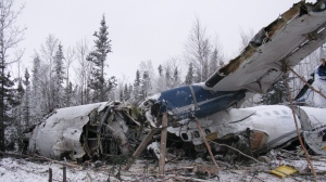 The wreckage of an aircraft is seen near Fond du Lac, Sask. on Thursday, December 14, 2017 in this handout photo.THE CANADIAN PRESS/HO, Transportation Safety Board of Canada.
