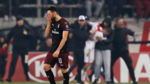 AC Milan's Hakan Calhanoglu leaves the pitch at the end a Group F Europa League soccer match between Olympiakos and AC Milan at Georgios Karaiskakis stadium in the port of Piraeus, near Athens, Thursday, Dec. 13, 2018. Olympiakos won 3-1. (AP Photo/Thanassis Stavrakis)