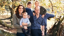 This photo released by Kensington Palace on Friday Dec. 14, 2018, shows the photo taken by Matt Porteous of Britain's Prince William and Kate, Duchess of Cambridge with their children Prince George, right, Princess Charlotte, center, and Prince Louis at Anmer Hall in Norfolk, east England, which is to be used as their 2018 Christmas card. (Matt Porteous/Kensington Palace via AP)