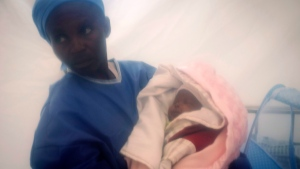 Ebola survivor cares for one week-old Benedicte