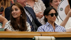 Kate, Duchess of Cambridge and Meghan, Duchess of Sussex, right, sit in the Royal Box on Centre Court ahead of the women's singles final match between Serena Williams of the US and Angelique Kerber of Germany at the Wimbledon Tennis Championships, in London, Saturday July 14, 2018. (AP Photo/Tim Ireland)