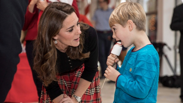 Kate, Duchess of Cambridge talks with five years old Harry O'Grady as she hosts a Christmas party for families and children of deployed personnel from RAF Coningsby and RAF Marham serving in Cyprus, at Kensington Palace, London, Tuesday, Dec. 4, 2018. (Richard Pohle/Pool photo via AP)