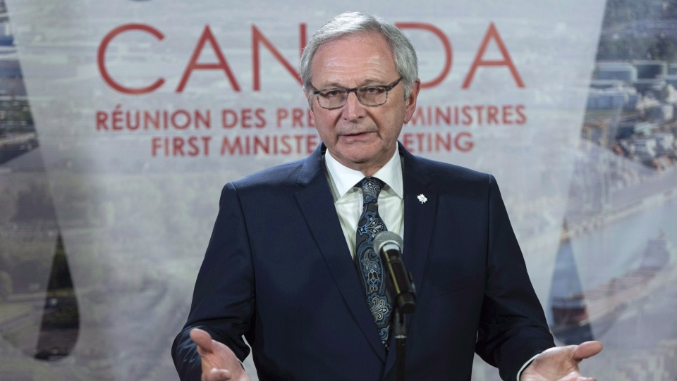 New Brunswick Premier Blaine Higgs responds to questions during a news conference at the first ministers meeting in Montreal on December 7, 2018. (THE CANADIAN PRESS/Paul Chiasson)