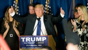 In this Feb. 9, 2016, file photo, then-Republican presidential candidate Donald Trump gives thumbs up to supporters during a primary night rally in Manchester, N.H.  (AP Photo/David Goldman, File)