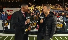 Actor Ryan Reynolds (right) speaks to Michael Strahan during the NFL half-time show on Dec. 13, 2018.
