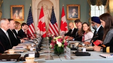 Secretary of State Mike Pompeo, fourth from left, and Defense Secretary Jim Mattis, third from left, meet their Canadian counterparts Canadian Minister of Foreign Affairs Chrystia Freeland, forth from right, and Canadian Minister of Defense Harjit Sajjan, third from right, during the U.S.-Canada 2+2 Ministerial at the State Department in Washington, Friday, Dec. 14, 2018. (AP / Manuel Balce Ceneta)