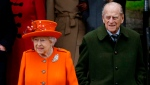 In this file photo dated Monday, Dec. 25, 2017, Britain's Queen Elizabeth II and Prince Philip, wait for their car following the traditional Christmas Day church service, at St. Mary Magdalene Church in Sandringham, England. (AP Photo/Alastair Grant, FILE)