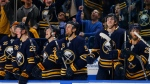 Buffalo Sabres teammates celebrate a 3-1 victory over the Arizona Coyotes following the third period of an NHL hockey game, Thursday, Dec. 13, 2018, in Buffalo N.Y. (AP Photo/Jeffrey T. Barnes)