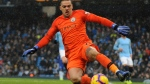 Manchester City's Ederson Moraes slides for the ball during the English Premier League soccer match between Manchester City and Everton at Etihad stadium in Manchester, England, Saturday, Dec. 15, 2018. (AP Photo/Rui Vieira)