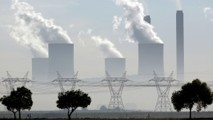 In this Wednesday, Dec. 5, 2018 file photo smoke billows from the chimneys at Lethabo Power Station, a coal fired power station, in Vereeniging, South Africa. (AP Photo/Themba Hadebe, File)