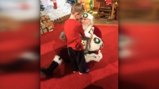 Boy with autism has a special meeting with Santa