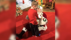 "Six-year-old Matthew Foster, who is blind and autistic, had an unforgettable visit with Santa Claus who down on the floor beside the boy so Foster could ""see"" Santa by touch."