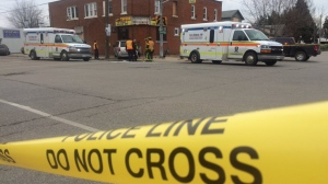 Police contain the scene of a two-vehicle crash at College and Campbell Avenues.