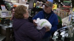 Lottery winner Margie Stewart, left, buys a Christmas turkey for a stranger in Pictou County, N.S. (CTV Atlantic)