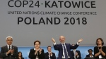 Michal Kurtyka, a senior Polish official chairing the negotiations, poses for a photo after adopting the final agreement during a closing session of the COP24 U.N. Climate Change Conference 2018 in Katowice, Poland, Saturday, Dec. 15, 2018. (AP Photo/Czarek Sokolowski)