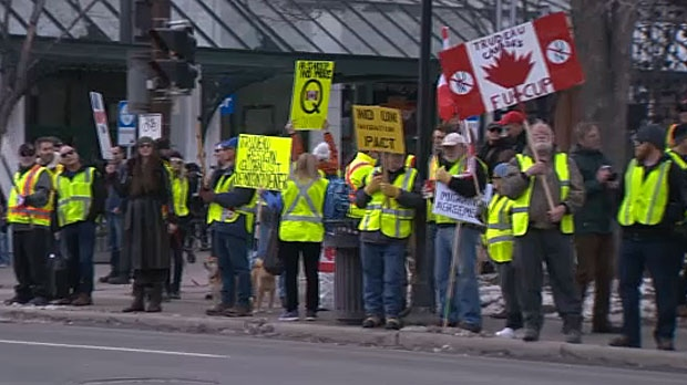Just over 100 people took part in a protest against the policies of the federal and provincial government at Olympic Plaza in Calgary.
