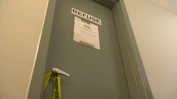 On the tenth floor, police tape hangs from a door handle. (Source: Beth Macdonell/CTV News)
