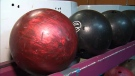 Bowling balls are lined up at Bathurst Bowlerama or a final time on Saturday, Dec. 15, 2018.